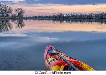 bow of whitewater kayak on lake - bow of whitewater kayak on...