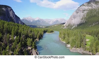 Bow River among Rockies Mountains in Banff National Park, ...