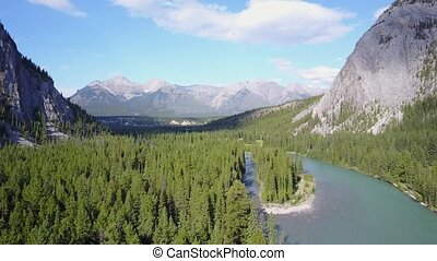 Bow River among Rockies Mountains in Banff National Park,...