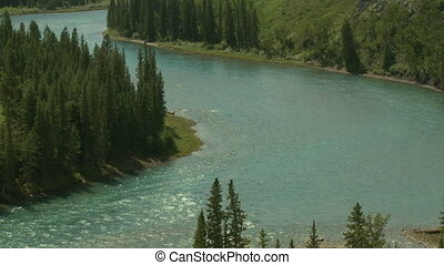 Zoom out on Bow River Valley in the foothills of the Rocky Mountains, Alberta, Canada