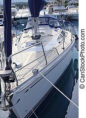 bow saiboat view white hull teak wood deck moored in marina ...