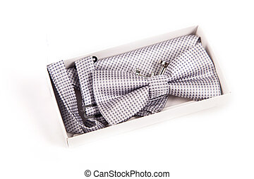 bow tie and cufflinks. the preparations of the groom and details of the wedding day isolate on white background