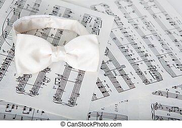 Bow-tie - White silk bow-tie on printed music sheets