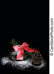 bow with pine tree and cone