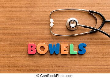 Bowels colorful word on the wooden background with stethoscope