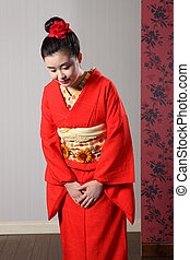 Bowing respect by Asian woman in Japanese kimono - ...