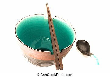 One Bowl with Chopsticks and Spoon on White Background
