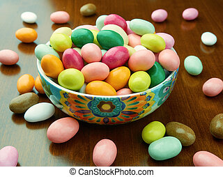Bowl filled up with colored sugared almonds