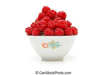 Bowl full of raspberries isolated on white