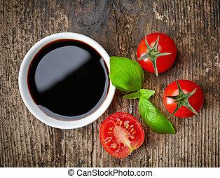 Balsamic vinegar - Bowl of Balsamic vinegar on wooden table