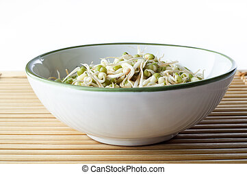 Bowl of Beansprouts on Bamboo Placemat - A bowl of mung...