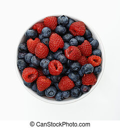 Bowl of berries. - Bowl of mixed blueberries and raspberries...