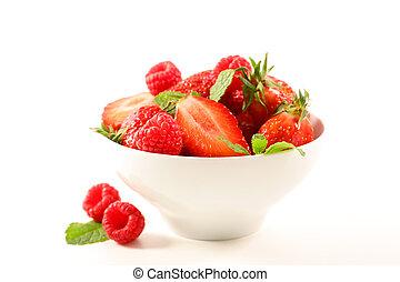 bowl of berry fruit salad isolated on white background