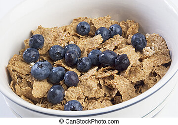 breakfast cereal - Bowl of breakfast cereal with blueberries
