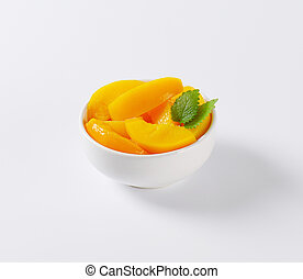 canned peach slices - bowl of canned peach slices