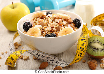 bowl of cereal, fruit and dumbbell