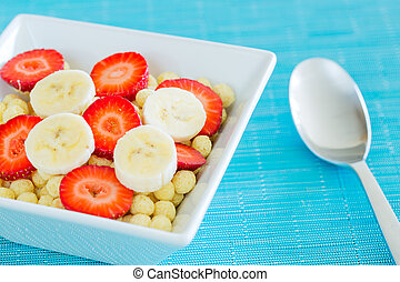 Bowl of Cereal with Fresh Strawberries and Bananas