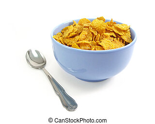 Cereal flakes in a blue bowl on white background