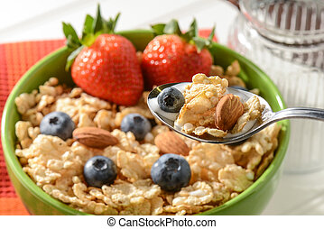 Bowl of Cereal with Strawberries, Blueberries and Almonds