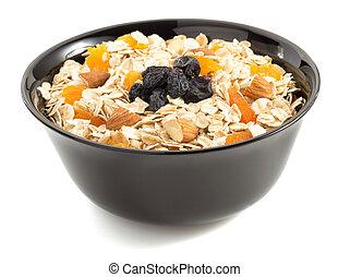 bowl of cereals muesli on white