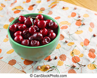 Bowl of cherries with stems, pits