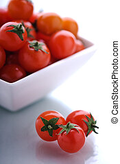 A bowl full of cherry tomatoes.