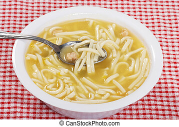 chicken noodle soup with spoon - bowl of chicken noodle soup...