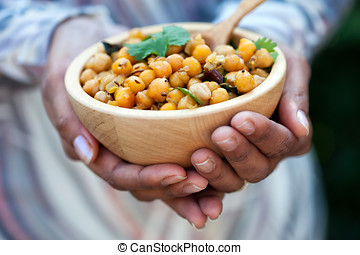 Bowl of chickpeas - Female hands holding a bowl of chickpeas