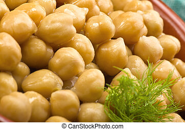 Bowl of chickpeas with fennel leaves, closeup shoot