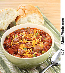 Bowl of Chili - Bowl of chili with cheese on top with bread...