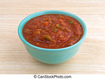 Bowl of chunky salsa sauce on table top side view - Side ...