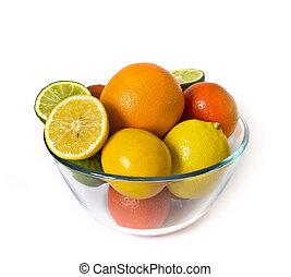 Bowl of citrus fruits on white background
