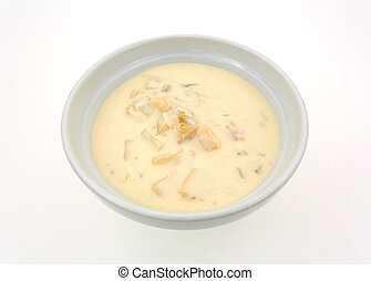 Bowl of clam chowder on a white table top