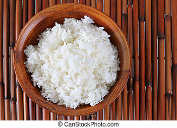 Bowl of Cooked Rice on Bamboo Platemat