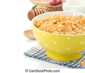 Bowl of corn flakes and milk isolated on white