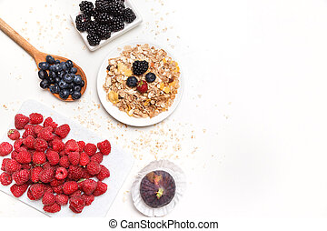 bowl of corn flakes with berries on white background.