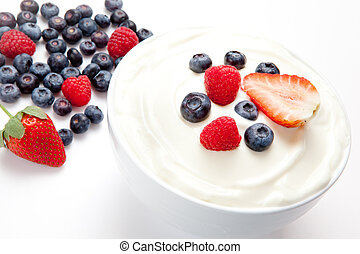 Bowl of cream with berries
