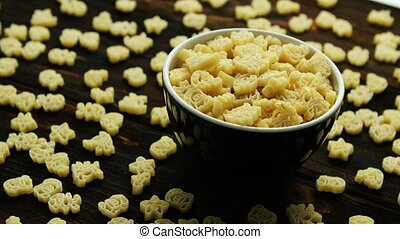 Bowl of creative small macaroni - Composition of macaroni on...