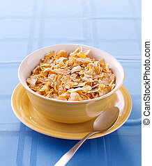 bowl of crunchy corn flakes for breakfast with copyspace
