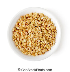 Bowl of crushed peanuts on white background, top view