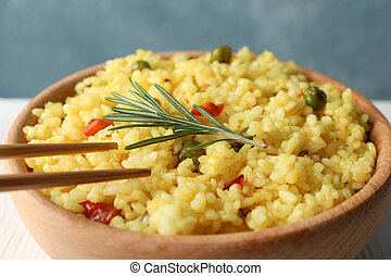 Bowl of delicious rice with vegetables, close up