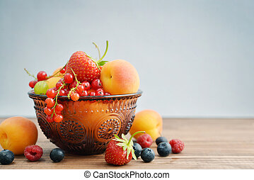 Bowl of different fresh berries