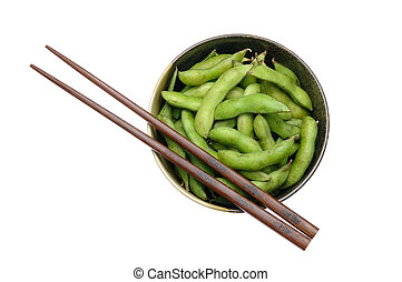 Bowl of edamame with chopsticks isolated on white