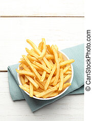 bowl of french fries on a turquoise napkin
