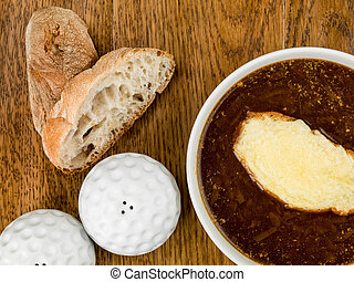 Bowl of French Onion Soup With Toasted Bread and Melted Cheese