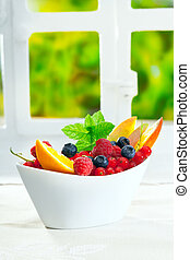 Bowl of fresh berries with copyspace