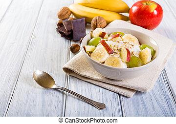 Bowl of fresh fruit. Healthy breakfast.