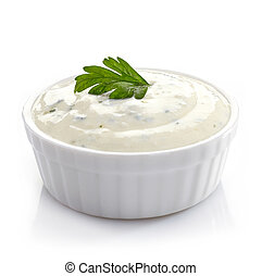Bowl of fresh garlic dip on white background