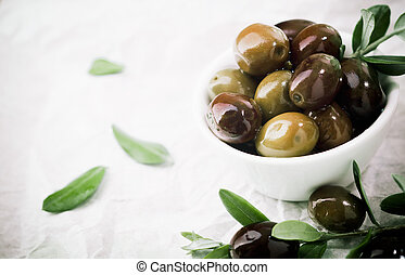 Bowl of fresh olives with copyspace