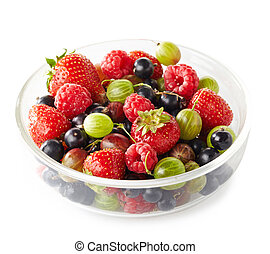 Bowl of fresh ripe berries on white background